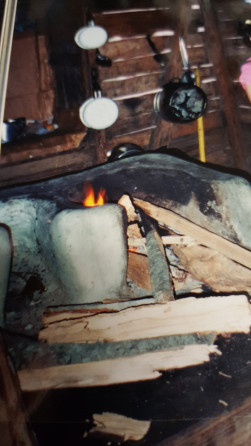 A fogon, an outdoor stove, was used in a small hut to keep the heat out of his grandmother's kitchen. It is pictured here.
