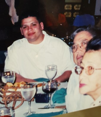 Orlando and his grandparents at a restaurant in the Dominican Republic.