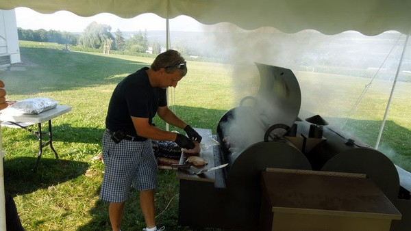 Production manager Tracey Miller, casually dressed and grilling hamburgers at Glenora's annual staff picnic