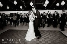 A black and white shot of a bride and groom dancing on the terrace at Veraisons Restaurant during their reception.