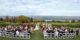 A wide shot of an early fall wedding ceremony, overlooking the vineyards and Seneca Lake