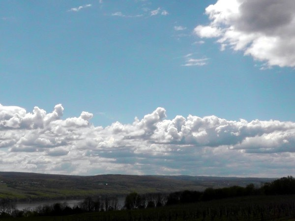 A beautiful sunny sky, with large white clouds,  over Seneca lake