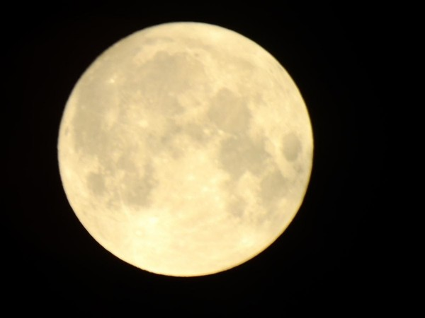 A full moon, captured from the East Side of Seneca Lake